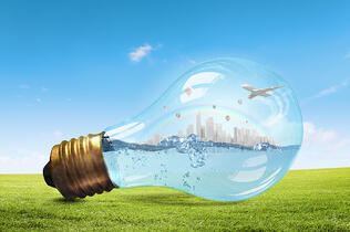 Glass light bulb with water and cityscape inside-1