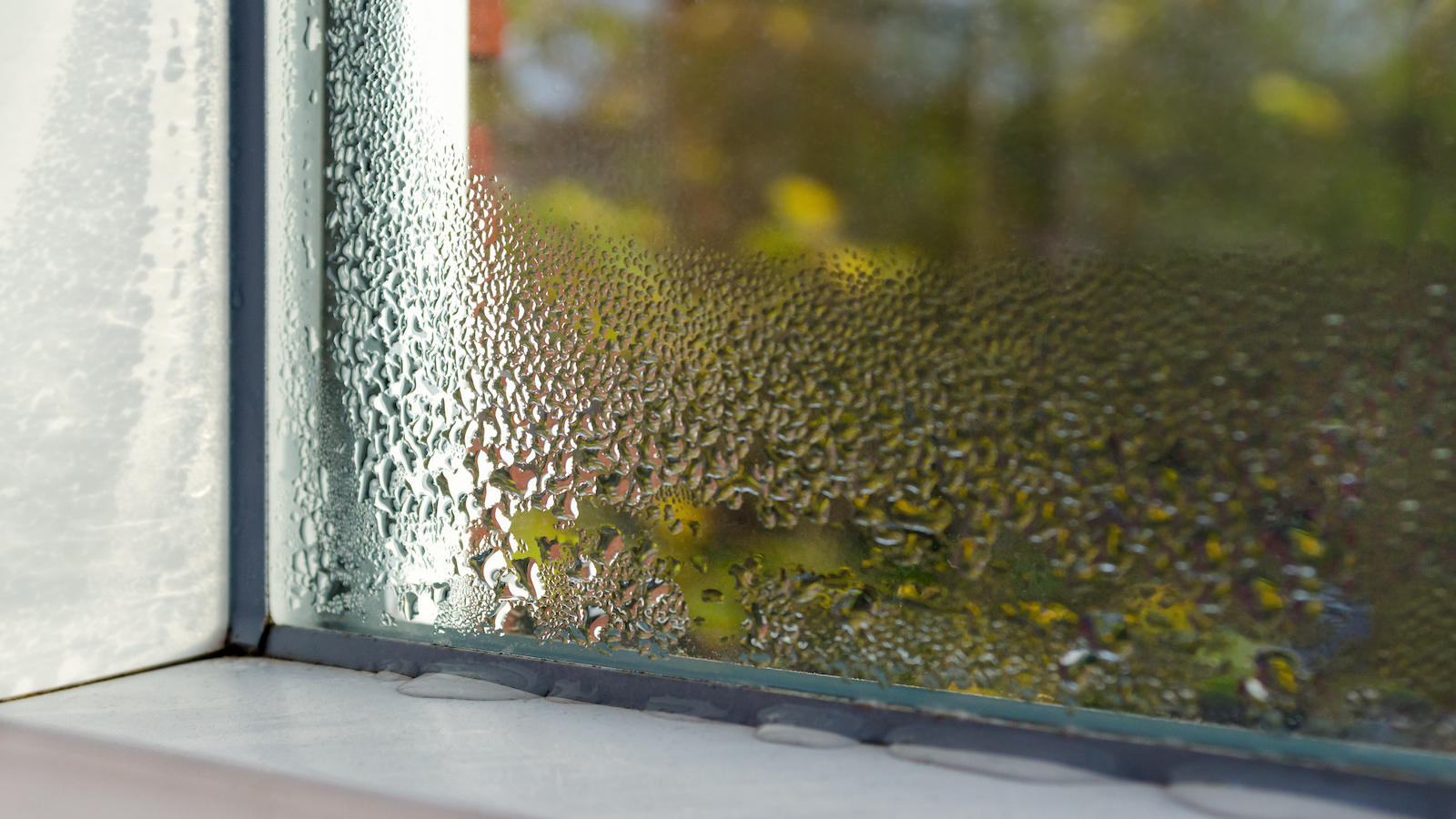 Window with water drops from humidity