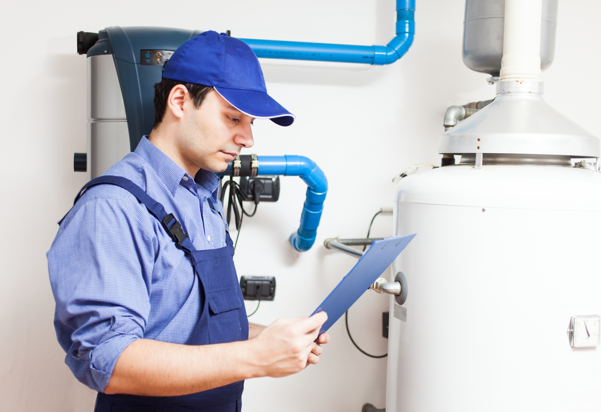 technician with a hot water heater